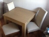 Next expanding dinning table and four chairs