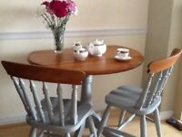 Refurbished drop leaf pine table and two chairs