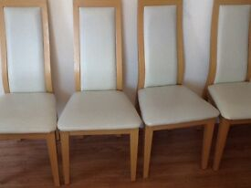 Four coffee cream and beige dining chairs