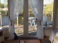 Holiday home for sale. River front position. 2 Bedrooms, 2 bathrooms.