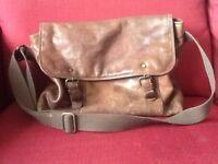 Leather, messenger style shoulder bag.