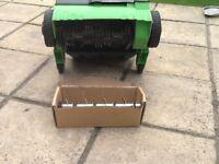 Garden lawn scarifier