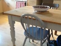 A pine table with a draw