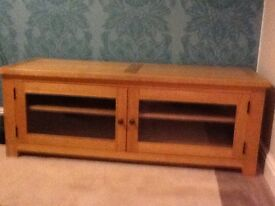 Solid wood oak living room unit with 2 glass doors and cd storage