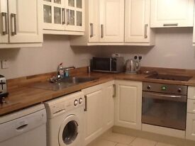 Large 2 Bedroom Ground Floor Apartment Fully Furnished with Master En-suite, Private On Site Parking