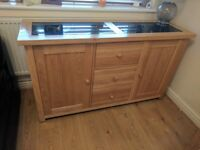 Large solid oak side board with 3 centre draws and two side cupboards