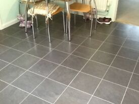 Laminate flooring in slate grey tiled effect (4 mtrs x 3 mtrs approx)