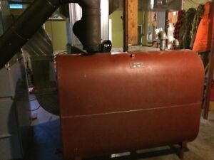 Wood/oil furnace with tank and all the duct work! 1500 obo