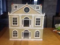 Sylvanian family dolls house in good condition. Very rarely used and priced to sell quickly.