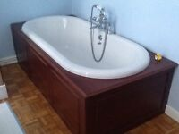 Roll top bath with wood panels, wash basin and pedestal, taps included all in good condition