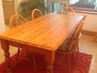 6 seater pine table and 6 pine chairs with cushions