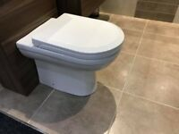back to wall toilet pan and soft close seat NEW
