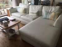 Large white leather sofa bed with chaise