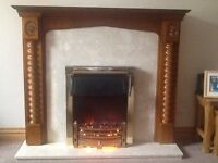 Wooden fireplace with marble back panel/hearth and electric fire.