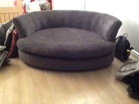 Beautiful cuddler and 3 seater couch in charcoal grey with matching cushions in grey and raspberry