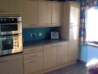 Modern kitchen units, including oven, hob and sink