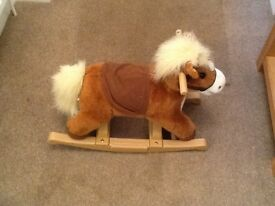 A small child's rocking pony.