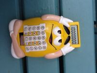 M&M yellow calculator - in working order and with battery