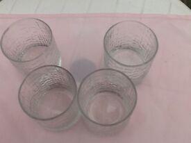 23 matching glass tumblers.