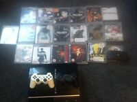 PS3 console with 2 wireless pads and 18 games and also game chair too!!!