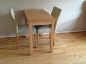 Extendable table and two dining chairs