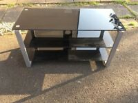 Black glass tv unit with metal stand