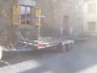 Car trailer, transporter, flat bed with loading ramp twin axle with winch.
