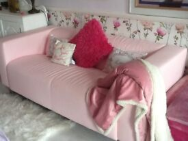 IKEA baby pink vinyl sofa 70 inches long X 33 inches deep. Great condition
