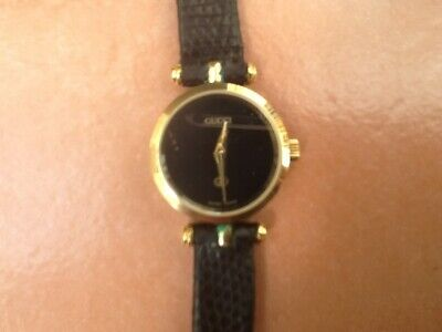 VINTAGE GUCCI LADIES GOLD PLATED 22MM SWISS DRESS WATCH, BLACK LEATHER STRAP