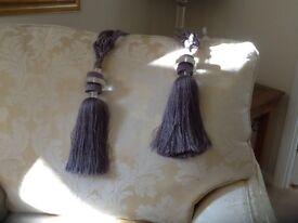 Pair of grey curtain tie backs with tassel