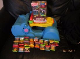 FISHER PRICE PEEK A BOO HIPPO WALKER WITH 26 BLOCKS THE HIPPO PICKS UP THE BLOCKS