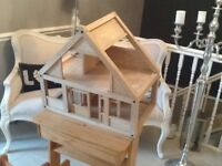 Wooden dolls house.