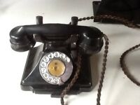 Dynamic trio of black GPO dial telephone plus separate bell set and wall stand