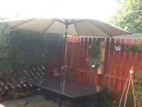 Garden table and parasol