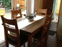 Solid oak farmhouse table and four chairs