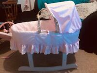 Pink Moses basket and rocking stand