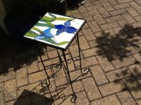 Pair of wrought iron decorative side tables.
