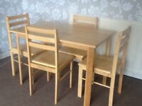 Solid pine dining table with chairs