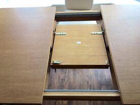 Oak veneer 'Next' dining room table & four chairs
