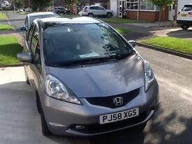 Honda Jazz I-VTEC EX 5 door hatchback in silver 1339 cc, with panoramic electric sun roof.