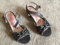 Girls black sparkle shoes children's size 12 with a small heel Velcro fastening