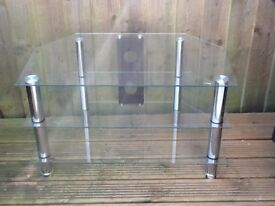 Corner television table in clear toughened glass good condition.