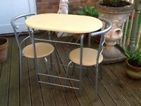 Beech effect dining table and 2 chairs