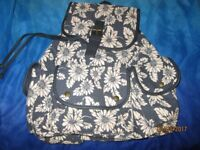 measures 16 x 11 inch DAISY PATTERNED BACKPACK FROM CLAIRES NEW