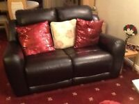 Two Seater Dark Brown Faux Leather Sofa. Only 1 year old.