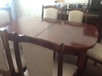 Dining table and six chairs solid mahogany never been used extendable quality item