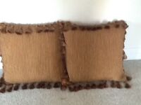 2 golden brown lounge cushions with tassels Very good quality