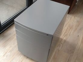 Grey metal filing cabinet, two top draws and one deep filing draw.