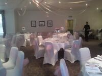 White chair covers, arch fronted, stretchy material.