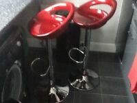 Bar stool, red and chrome, are like new, never sat on